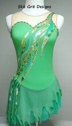 Peter Pan's Tinkerbell Figure Skating Dress, Sk8 Gr8 Designs in apple green with gold,kelly green, and lace appliques, tattered skirt, and Swarovski rhinestones in olivine, peridot, crystal AB, citrine and golden shadow. www.sk8gr8designs.com