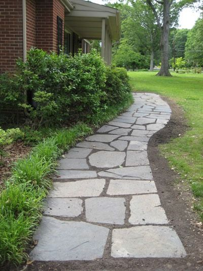 DIY Curb Appeal Projects - A slate walkway adds a fun pattern to your home's exterior.