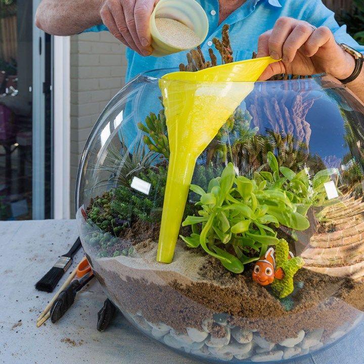 Use a funnel when adding sand to a beachy terrarium!