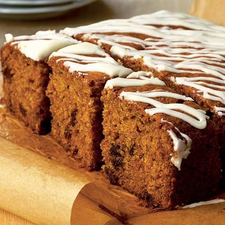 Yummy Scrummy Carrot Cake Recipe Afternoon Tea, Desserts with muscovado sugar, sunflower oil, large eggs, carrots, raisins, orange, self rising flour, bicarbonate of soda, ground cinnamon, grated nutmeg, powdered sugar, orange juice