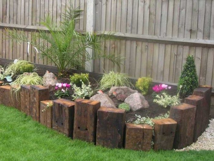 Best 25 railroad ties landscaping ideas on pinterest for Best plants for front flower bed