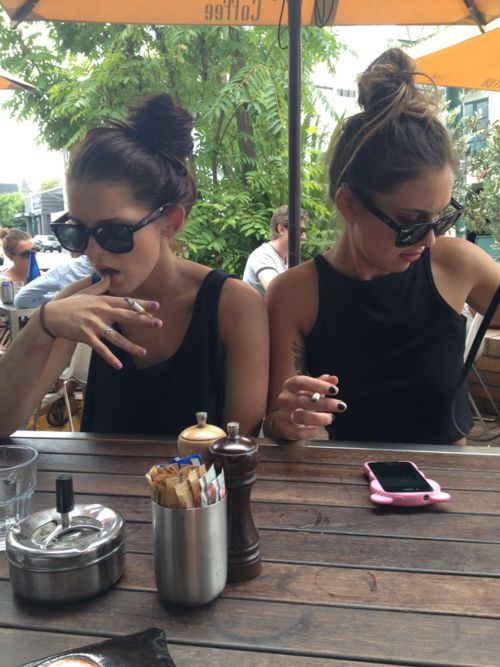 top knot. shades. black nails.   awesome.