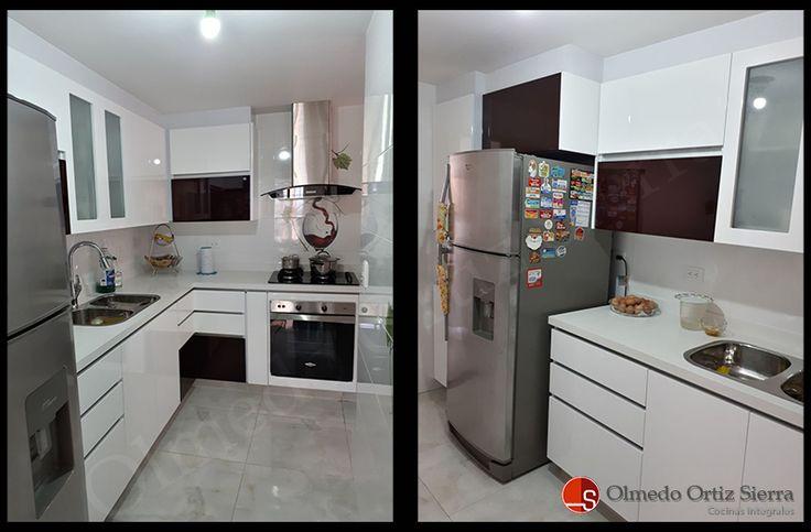 Cocina en poliuretano, combinación blanca y vinotinto, cubierta en quarztone blanco y cajones esquineros para mejor aprovechamiento de espacios.