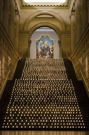 A display of 1,200 votive candles lined the stairs in the Great Hall at the Metropolitan Museum of Art and was one of the first visuals the... Photo: Carolyn Curtis for BizBash