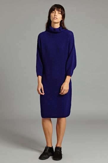 Dita Cashmere Dress in Bright Navy - This knitted cashmere dress is crafted with a distinctive waffle knit texture. It features a relaxed silhouette with high, rolled neck and batwing construction on the sleeves.