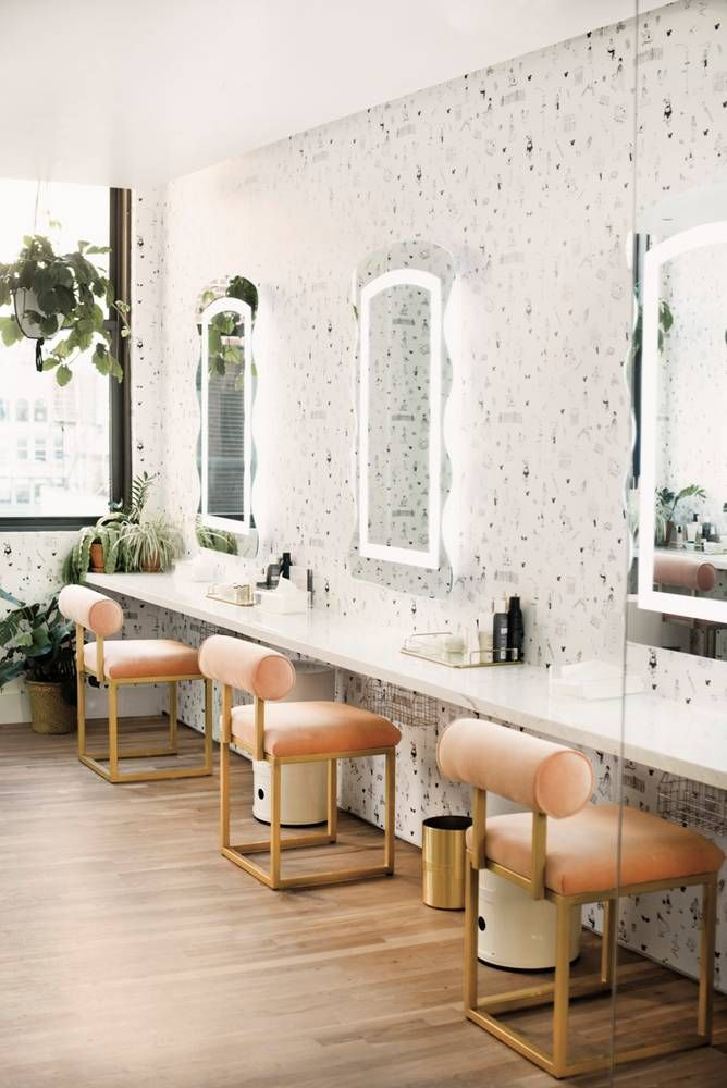 The Wing NYC Vanity - custom blush pink and gold chairs with neon mirrors and black and white wallpaper