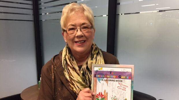 Saskatchewan artist Jeanne Burbage shows off her colouring book, The Zenimaginarium Garden.