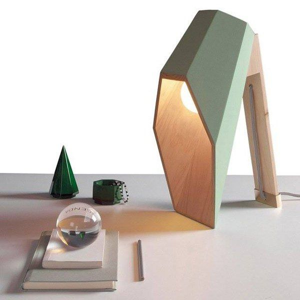 Wooden desk lamp. The homey design and the abundant lighting the lamp offers make it a perfect study lamp.