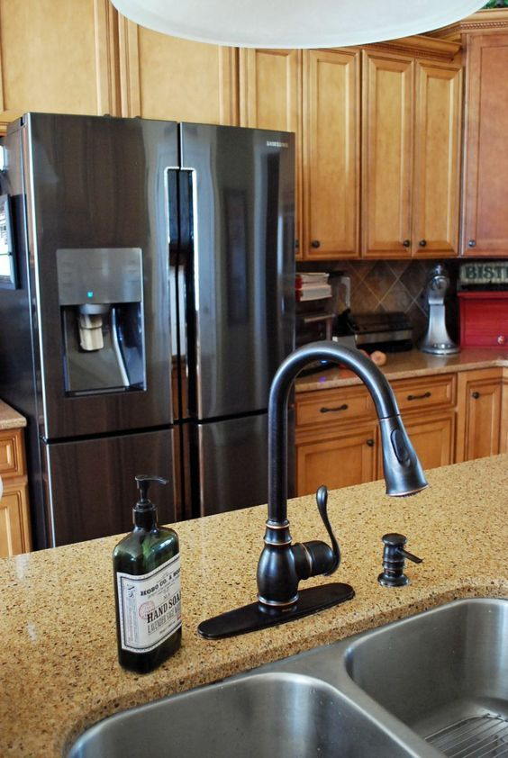 Black Stainless Steel, lighter cabinets and tan countertops