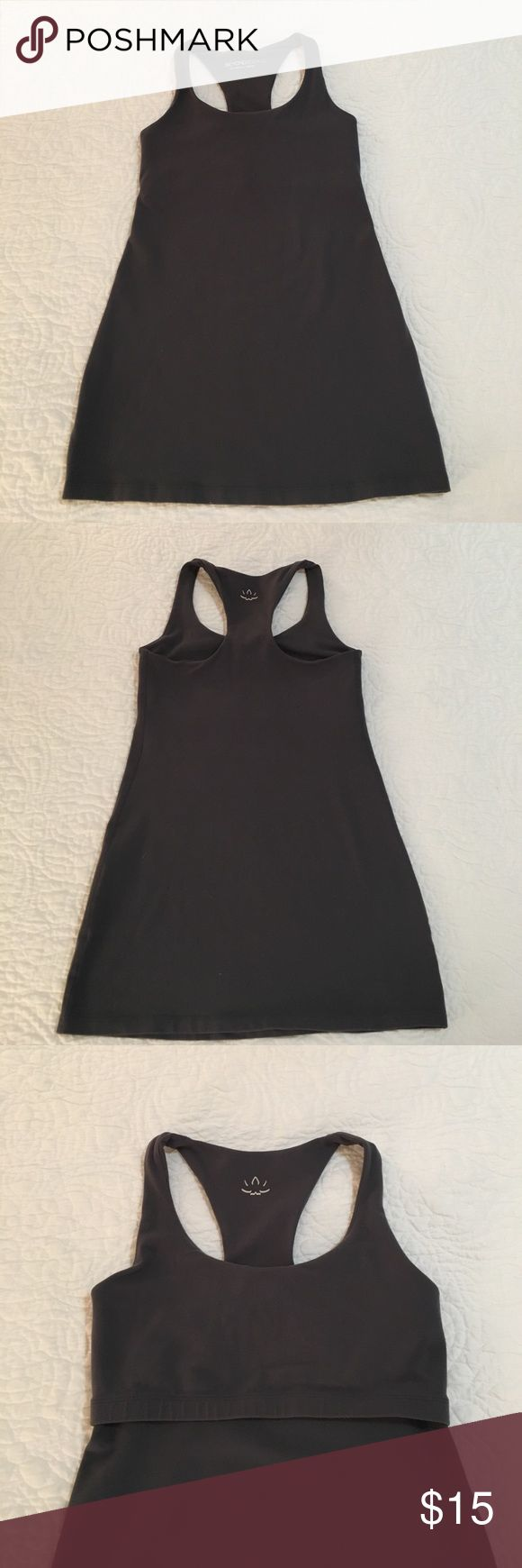 Beyond Yoga Cami with Built in Sports Bra Beyond Yoga top. Built in sports bra. Dark gray. This flattering, long-line Racerback Cami will be the workhorse of your wardrobe.  Material provides generous stretch and full recovery; retaining color and shape after every wash. Ideal for even the most vigorous workouts. Beyond Yoga Tops Tank Tops