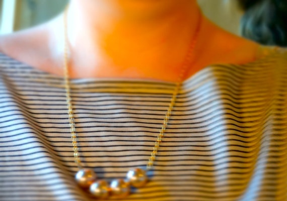 Gold coloured bead statement necklace by Kittycrabtree on Etsy, €10.00