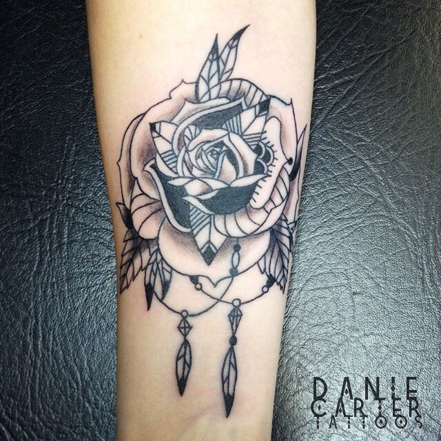 Stylised graphic rose black forarm tattoo
