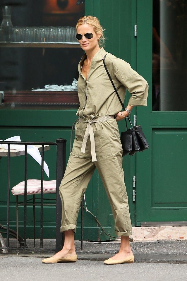 Carolyn Murphy in an army green jumpsuit, Celine trio bag and tan ballet slippers