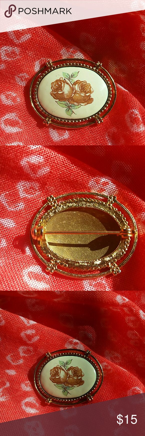 Vintage Oval Picture Frame Brooch Pretty pin brooch. Looks like an antique oval picture frame. Gold tone with cream colored background and double roses center. Vintage Jewelry Brooches