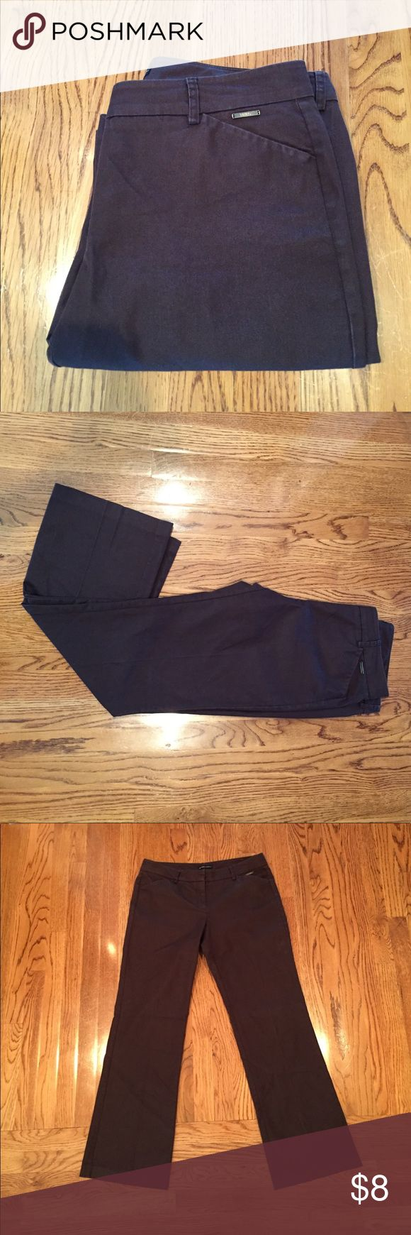 Brown slacks Brown slacks. In great condition. Flare style legs. Zipper and buttons all in working condition. New York & Company Pants Trousers