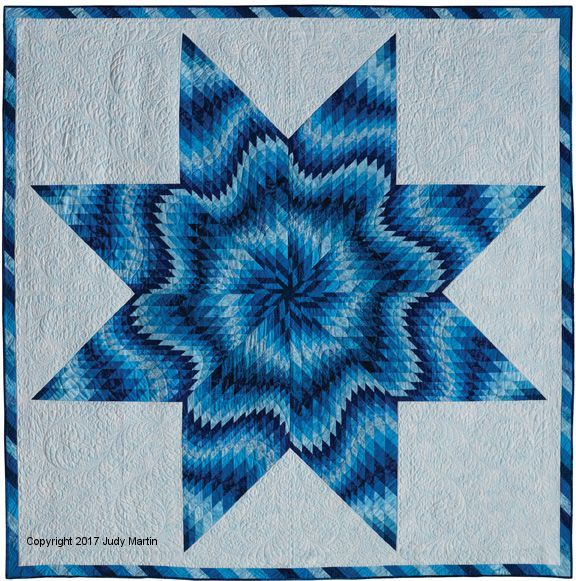 Wave on Wave, strip-pieced quilt from the book, Singular Stars: Judy Martin's Book of Lone Star Quilts. Designed by Judy Martin, pieced by Chris Hulin, quilted by Lana Corcoran. The book will be published in the fall of 2017.