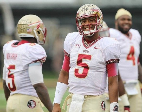 FSU quarterback Jameis Winston flashes his trademark smile after a Seminole touchdown.
