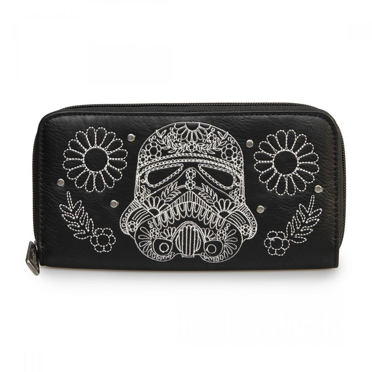 The Star Wars Storm Trooper Walking Stitch Floral Denim Wallet is a fully licensed, faux leather wallet with stitching of a Stormtrooper and flowers on the front of the wallet and a clear back. This subtle designed wallet is perfect for those who love the Star Wars trilogy.