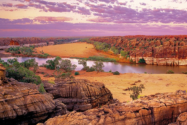 Fitzroy River, Geikie Gorge, WA.  In the Geikie Gorge National Park, this sunrise shot captures the limestone cliffs and sandy banks of the Fitzroy River. Picture: Ken Duncan.