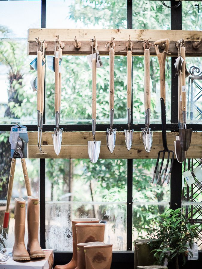 Petersham Nurseries - a taste of the countryside in London| wellington boots aka wellies, beautiful wooden handle spades // Photo by @chikaeoh