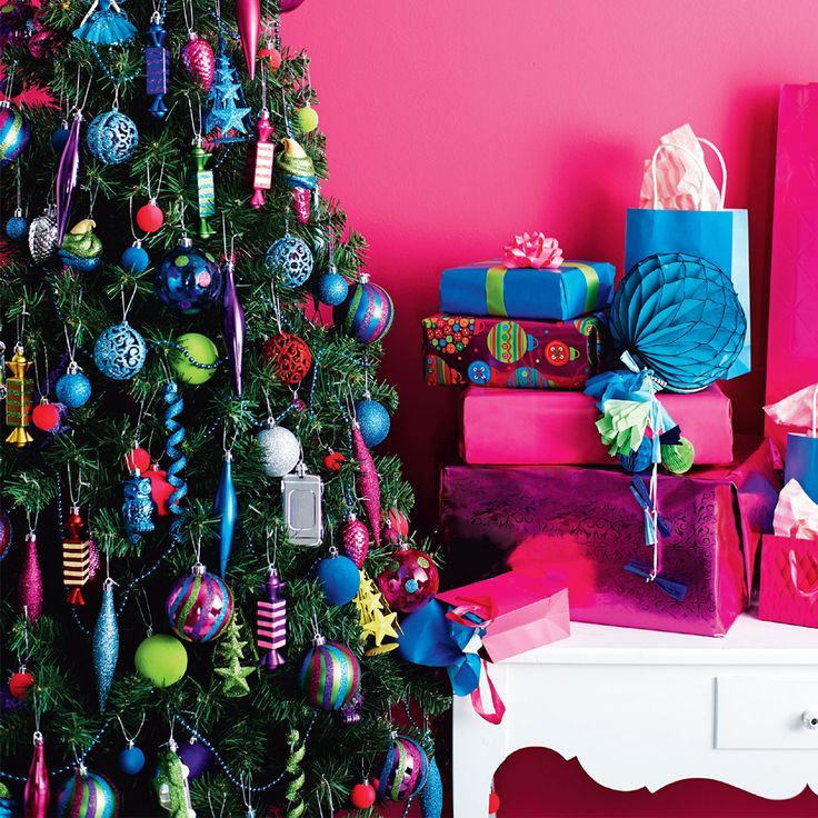Go for a bold and bright theme, with our rainbow range of neon decorations and wrapping papers. #Woolworths #Chirstmas #Decorations #giftwrapping #Inspiration
