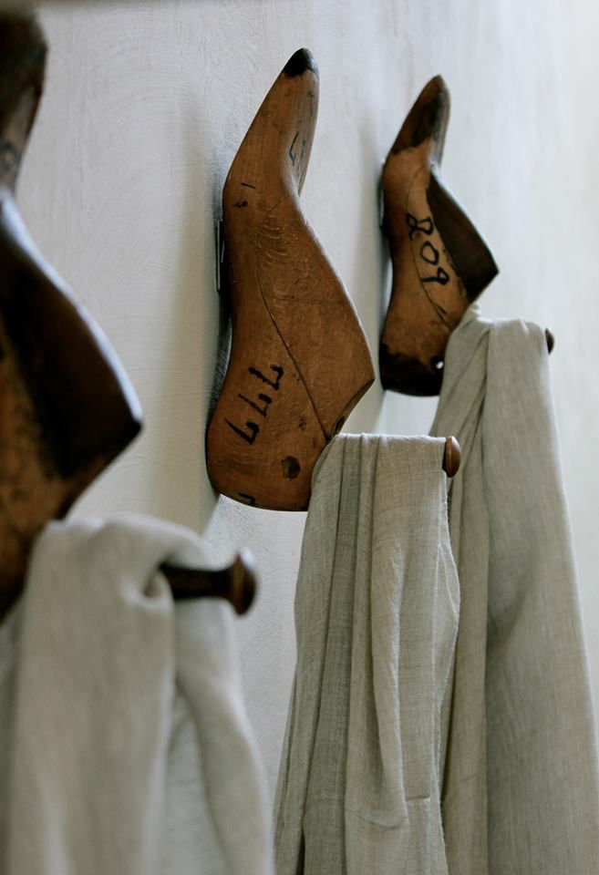 Repurposed wood shoe forms as towel hooks for bath