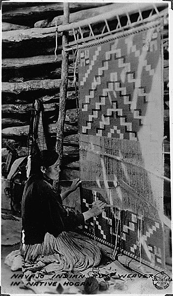 Navajo Indian rug weaver with partially completed rug in loom. Southern Navajo Agency, 1933 - NARA