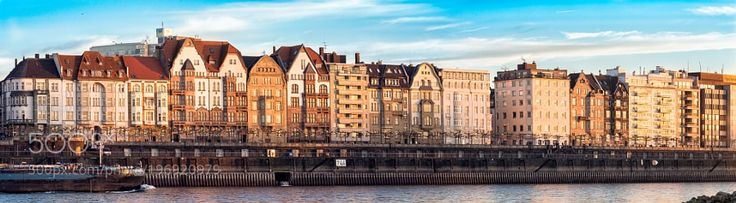DUESSELDORF GERMANY - JANUARY 20 2017: The skyline of the famous Altstadt glows in the warm... by axeldfischer