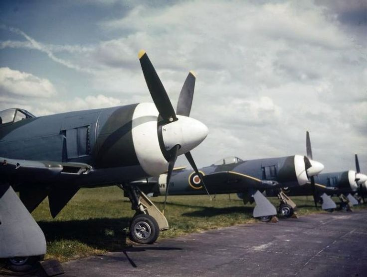 Royal Air Force Hawker Tempest Mk II lined up at the Hawker Aircraft Ltd factory at Langley, Berkshire, England - 1945