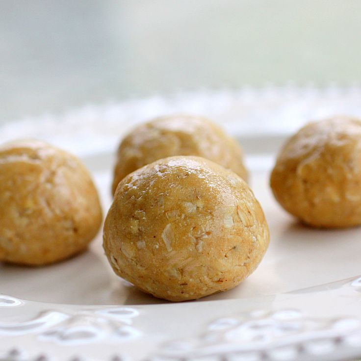 Healthy Peanut Butter Balls | 1/2 cup creamy peanut butter,  1/2 cup honey,  3/4 cup nonfat powdered milk,  3/4 cup quick-cooking oats -  Combine all ingredients; mix well. Using your hands, roll the dough into balls about the size of large gumballs. Place on a cookie sheet lined with wax paper, and refrigerate until set. Makes about 18 balls.