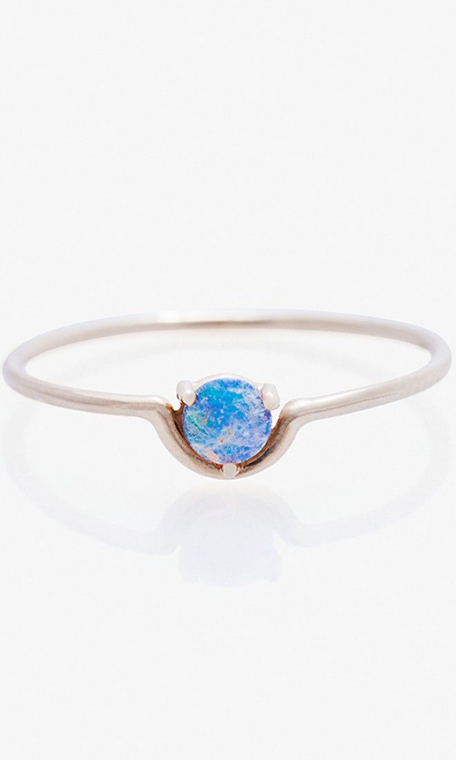 Add some glimmer to your oufit with this opal stone, nestled in the curve of a 14 karat gold band