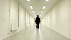 A Group 4 security officer walks down one of the corridors of Yarl's Wood Immigration Removal Centre, Europe's largest detention centre for illegal immigrants, in Bedford (Reuters/Russell Boyce)
