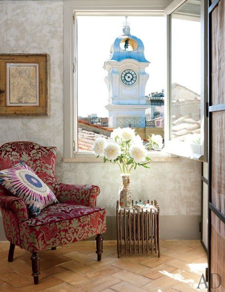 A bathroom window frames a bell tower; the drawing is by Sandro Chia, the chair is 19th century, and the table is by Gio Ponti. Livia Rebecchini's Apartment in Rome, Architectural Digest