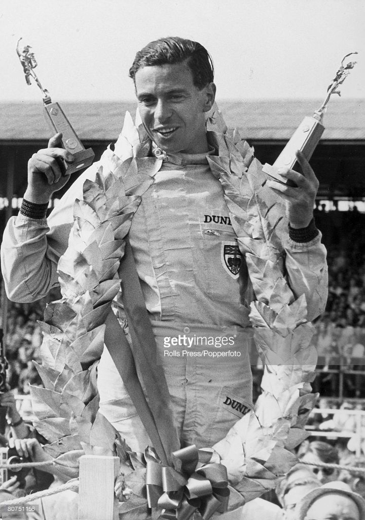 20th July 1963, British Grand Prix at Silverstone, Great Britain's Jim Clark with his trophies and victory garland, after driving his Lotus-Climax to victory in the the race, Jim Clark, a Scot, was World Champion twice in 1963 and 1965