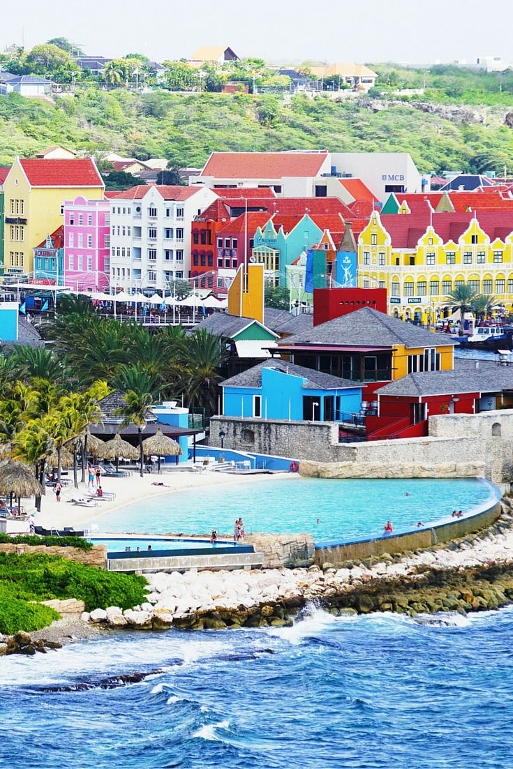 Willemstad, Curacao! This post does not contain industrial soot stained cities; instead it showcases some of the most vibrant looking cities in the world. Click through to see some of the most colorful cities in the world!