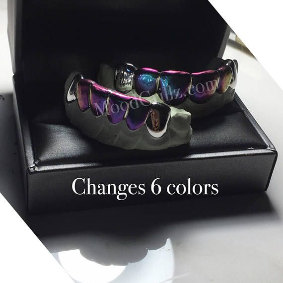 Color Changing Colored Grillz Custom Fit Gold Grillz REAL Color Grill Grillz Iridescent Grillz -Custom Gold Grillz For Men & Women. Design Origin & Facts: I was grateful and honored to first create this piece for Erykah Badu. She is the first to rock my color changing grill in the