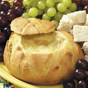 HOT BRIE DIP:  Saute 1 med onion, chopped fine; & 2 tsp garlic, minced; in 2 T butter until golden. Soften 1 8oz pk cream cheese in micro til soft. Cream and add 8 oz brie - trimmed & cut in pieces and micro less than 1 min. til soft. Mix in 3/4 c sour cream; 2 T lemon juice; 2 tsp brown sugar; 1 tsp Worchestershire sauce; salt & pepper to taste. Fill hollowed out round loaf. Wrap in foil & bake at 400 about 1 hr. til bubbly. Dust with paprika. Serve hot