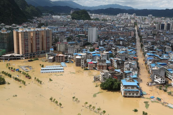 """""""A general view shows a flooded area in Liuzhou Guangxi province China on July 3 2017."""" Photo credit: Reuters / Stringer [3000 x 2000] [OS]"""