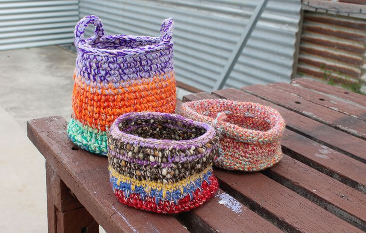 Hand woven baskets made from un-picked jumper wool and little yarn scraps. The short ones would be perfect for storing fresh eggs or as project storage baskets.