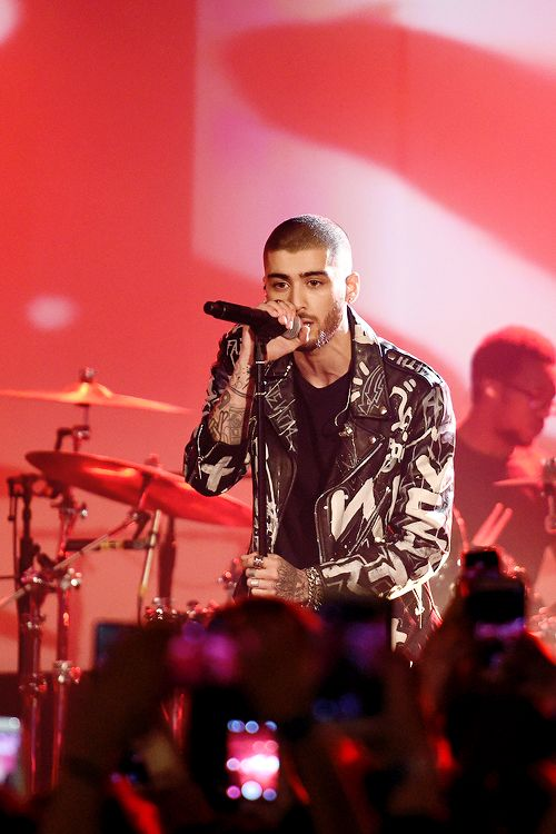 Zayn Malik performs onstage at ZAYN Album Release Party On The Honda Stage at the iHeartRadio Theater on March 25, 2016 in New York City