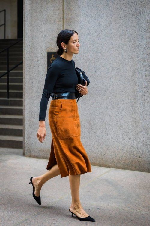 Black top, tan suede skirt, black kitten mules.