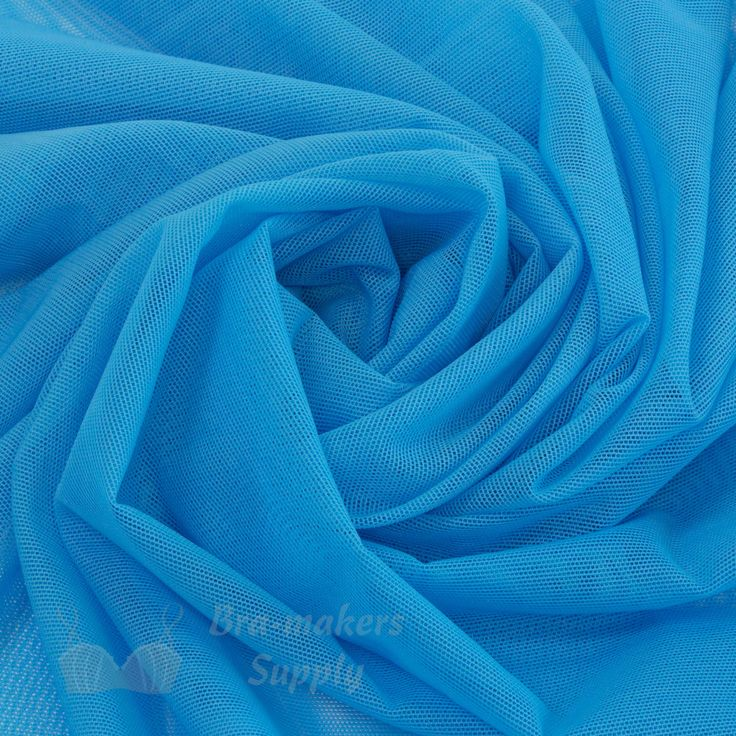 A very sheer and lightweight Stretch Mesh Fabric is very versatile, a great multipurpose material. Use for bras, dance costumes, skating costumes. 18 beautiful colours. #StretchMesh #MeshFabric