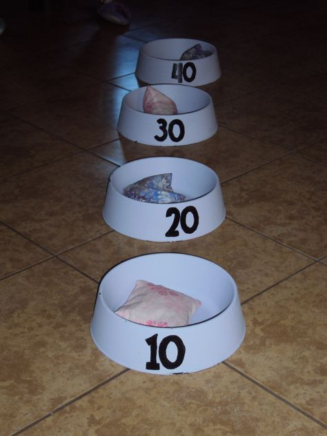 bean bag toss with dollar store dog bowls. Maybe a field day activity idea???