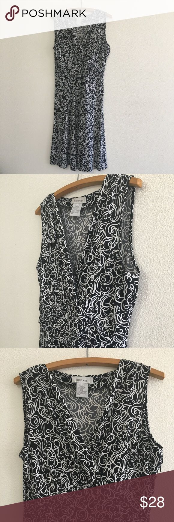 "Nine West Black & White Swirl Dress Gorgeous black and white dress! Has some stretch to it, overlap top and side zip. Semi pleated skirt. Perfect for day or night!  Size Large 44"" length (top shoulder to bottom)  19"" bust (pit-pit)   Bundle fav items for a personal discount. Offers are always welcome, too! No trades. Thank you! (12) Nine West Dresses Midi"