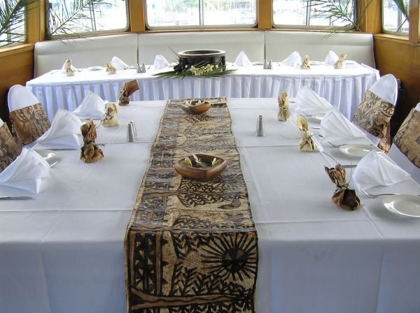 White Table Cloth - Tapa as Table Runner. White Serviettes adds class & makes it a lovely formal looking occasion.