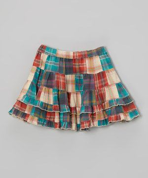 With its flounces of patchwork ruffles, this whirly twirly skirt is a bundle of fun. A comfy stretch waistband and soft cotton construction ensure the wearer will stay cozy all day.