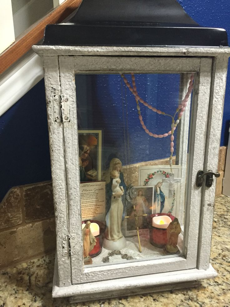 """Convert a lantern from a home goods store to create a miniature """"shrine"""" to hold prayer cards, relics, rosaries, and statues!  This is not intended for mere decoration; this is to help build a foundation of prayer and invitation to the communion of saints so that we may all be united in heart and soul with Christ. <3"""
