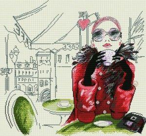 Un bonito cuadro de esta bella mujer tomando café en París, esta bordado a punto de cruz.