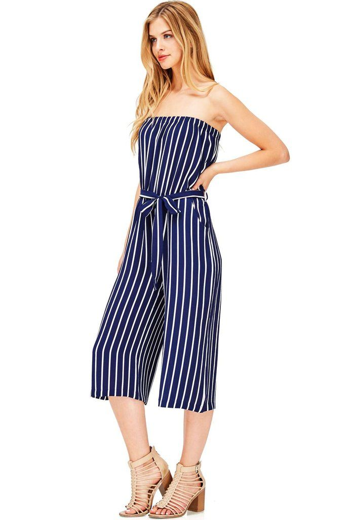 """Striped nautical jumpsuit with a tube top neckline and cropped wide leg fit. Stretchy elastic fitting across the top for a secure fit. Pockets at the sides with a waist tie. *Hand Wash Cold*97% Polyester 3% Spandex*38""""/97cm Top to Bottom 17""""/43cm Inseam - Measured on a size Small (Model is 5'7/wearing a size S)*Imported"""