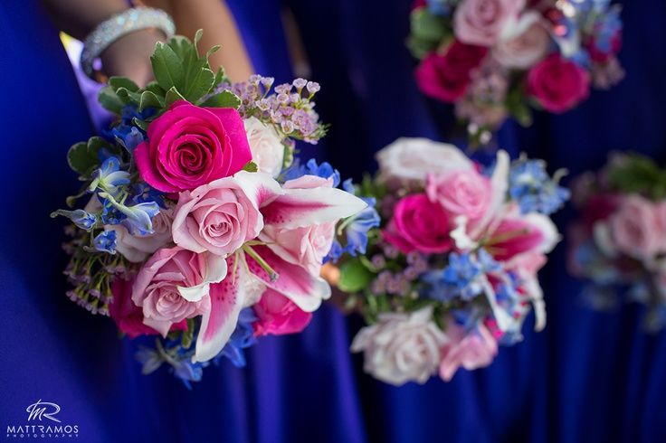 These pink, hot pink, white, blue, and lavender bridesmaid bouquets